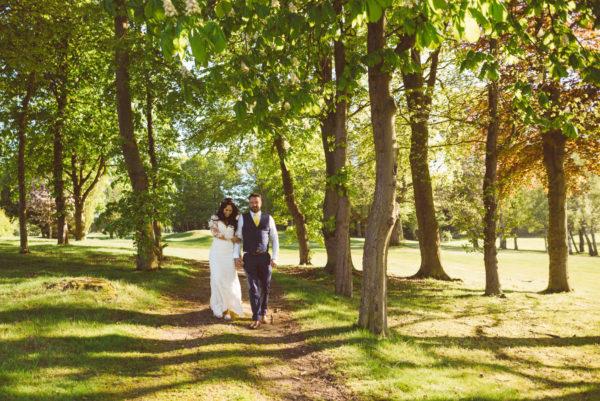 Bride & Groom walking in the gardens